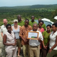 MIHINGO LODGE  The Mihingo Lodge team receiving their Going Neutral certificate from UCB in September 2012.